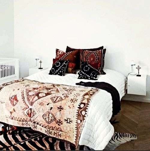 Love the combination of a minimal white room and rich embroidered bedding!  Take a look at www.bringingitallbackhome.co.uk for Indian textiles....