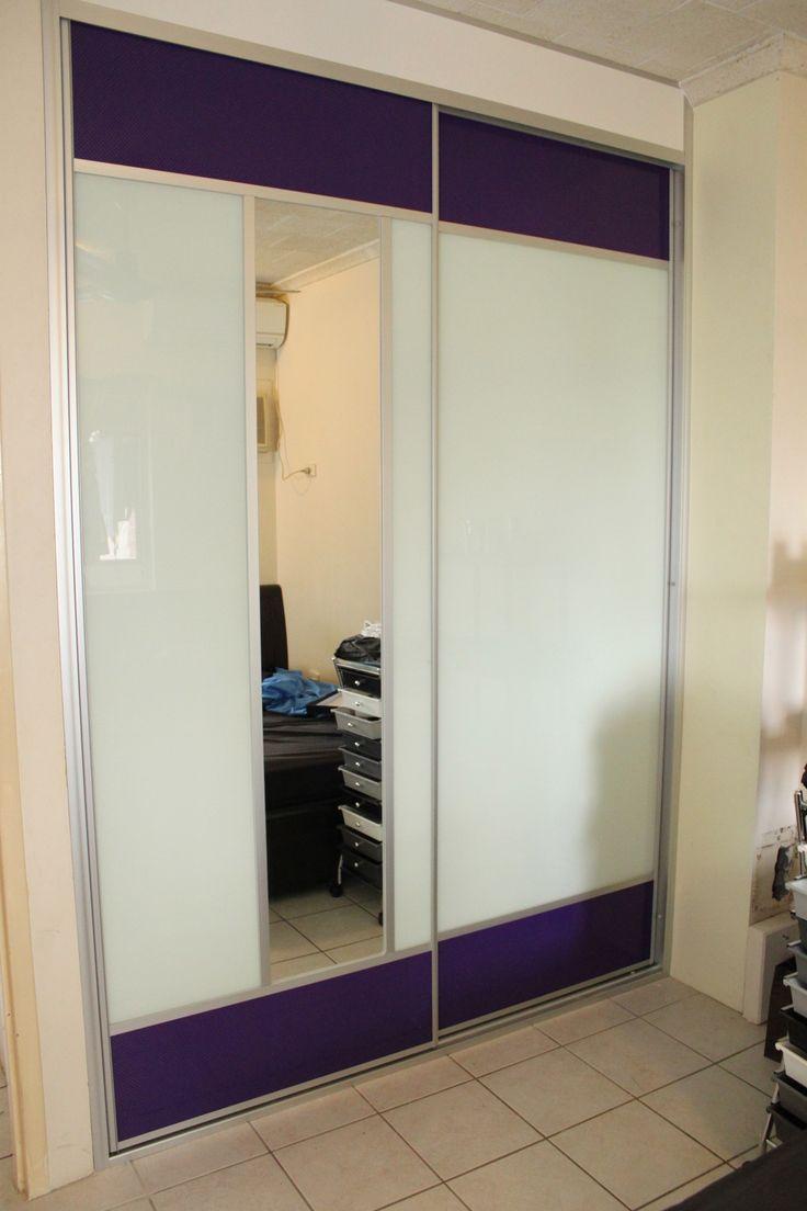 Troppo Doors using white glass, mirror and powder coated purple mesh.  www.formfunctionnt.com.au