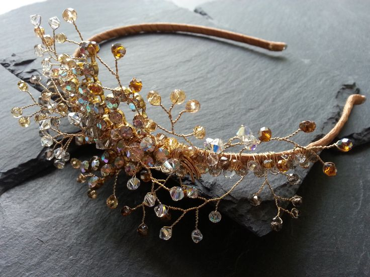Jewelled headdress made with vintage 1930's aurora borealis brooch and wire wrapped Swarovski crystals by Clare Lloyd www.vintagebuttonbridaldesigns.co.uk