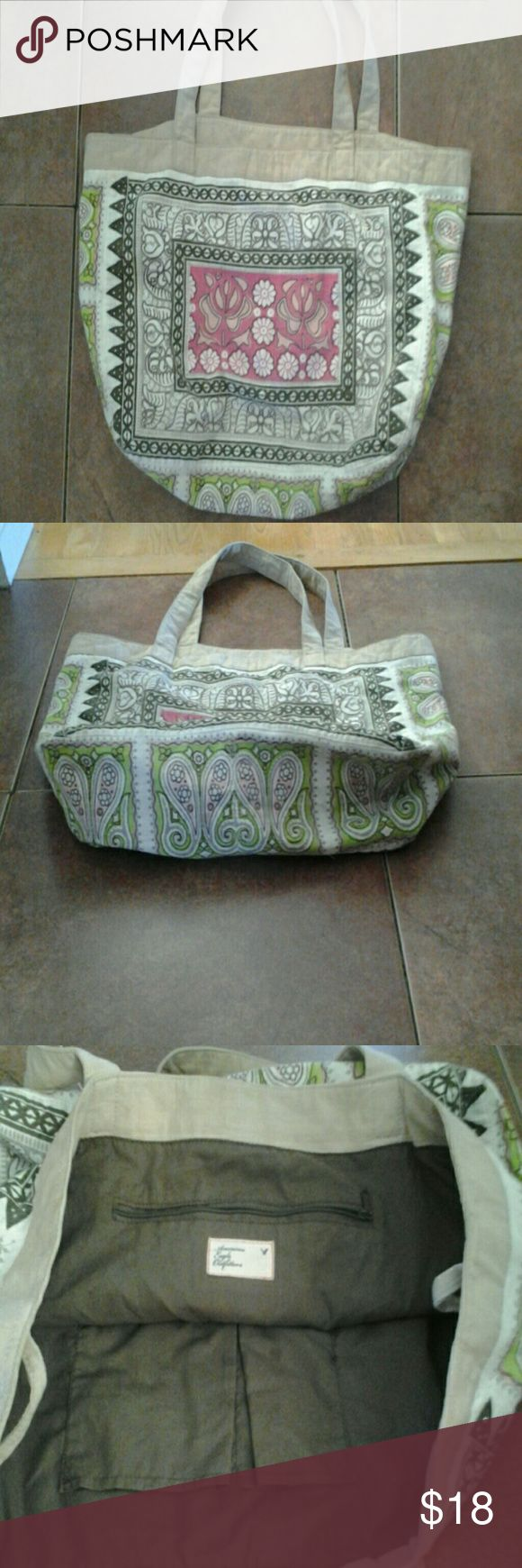 American Eagle Tote Bag Multi colored...(apple green, light pink,beige) cotton/linen with brown cotton lining. 1 zipper pocket inside and two inside pouch pockets. American Eagle Outfitters Bags Totes