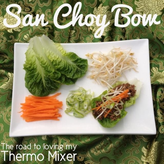 San Choy Bow 1 onion, peeled and quartered 2 garlic cloves, peeled 10g oil, peanut or sesame works well in this dish 500g good quality beef or pork mince 45g soy sauce 50g oyster sauce 1/2 teaspoon of pepper 1-2 baby cos lettuce heads, leaves pulled apart 2 carrots, thinly sliced 100g bean sprouts 4 shallots/spring onions, thinly sliced on a diagonal