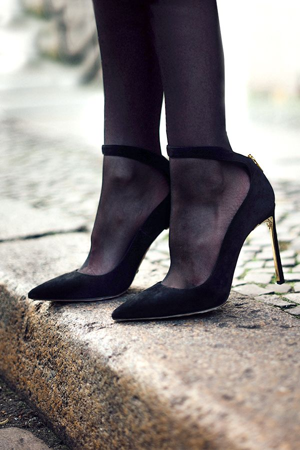Set on a shimmering gold-trimmed stiletto heel, Sebastian's black suede pumps are sensational. A guaranteed conversation starter, wear with sheer tights to add casual elegance to a cold weather knit.