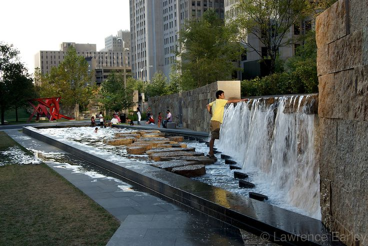The rushing fountains at Citygarden, St. Louis attract children. It's an important landscape design element at the sculpture garden.