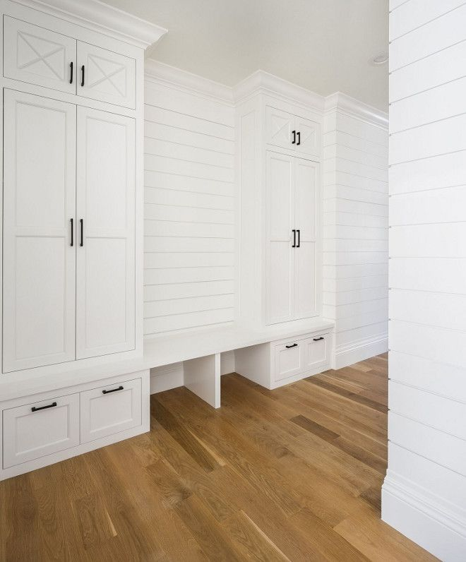 Shiplap Mudroom. Mudroom features shiplap paneling and the same white oak flooring with matte finish. Walls and cabinet paint color is Benjamin Moore OC-117 Simply White. Shiplap Mudroom Ideas. Shiplap Mudroom Cabinet. Shiplap Mudroom Paneling #Shiplap #Mudroom Fox Group Construction