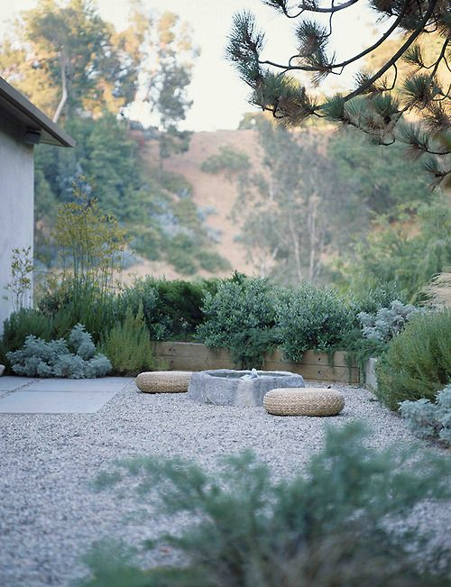 Color scheme, stone softened by nice gray plantings, water feature, coniferous tree in foreground