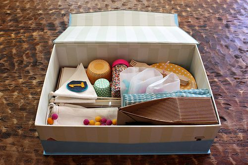 Birthday Party in a Box: include items such as cake mix, candles, cupcake liners, sprinkles, pom-pom garland, confetti, and balloons