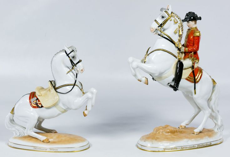 """Lot 270: Royal Vienna and Augarten Wien Porcelain Horse Figurines; (2) items including a horse and rider figurine """"Courbette"""" marked """"Wien"""" on the underside and a Lipizzaner horse """"Levade"""" with the """"Augarten Wien Austria"""" mark on the underside"""