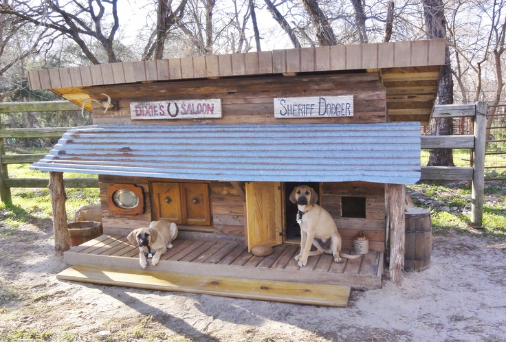 Dixie and Dodger's Wild West Dog House is finished!  It took a month of weekends to build and it sure fits in here at the ranch.  The floor is tiled with our old kitchen back splash and the exterior walls are reclaimed hardwood floors from the old Hunters Cabin. We repurposed tile from an old back splash for their floor. In fact, 99% of it is made with reclaimed materials. The puppies love it!
