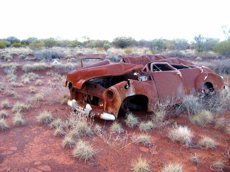 An FJ Holden in the middle of the Australian Western Desert