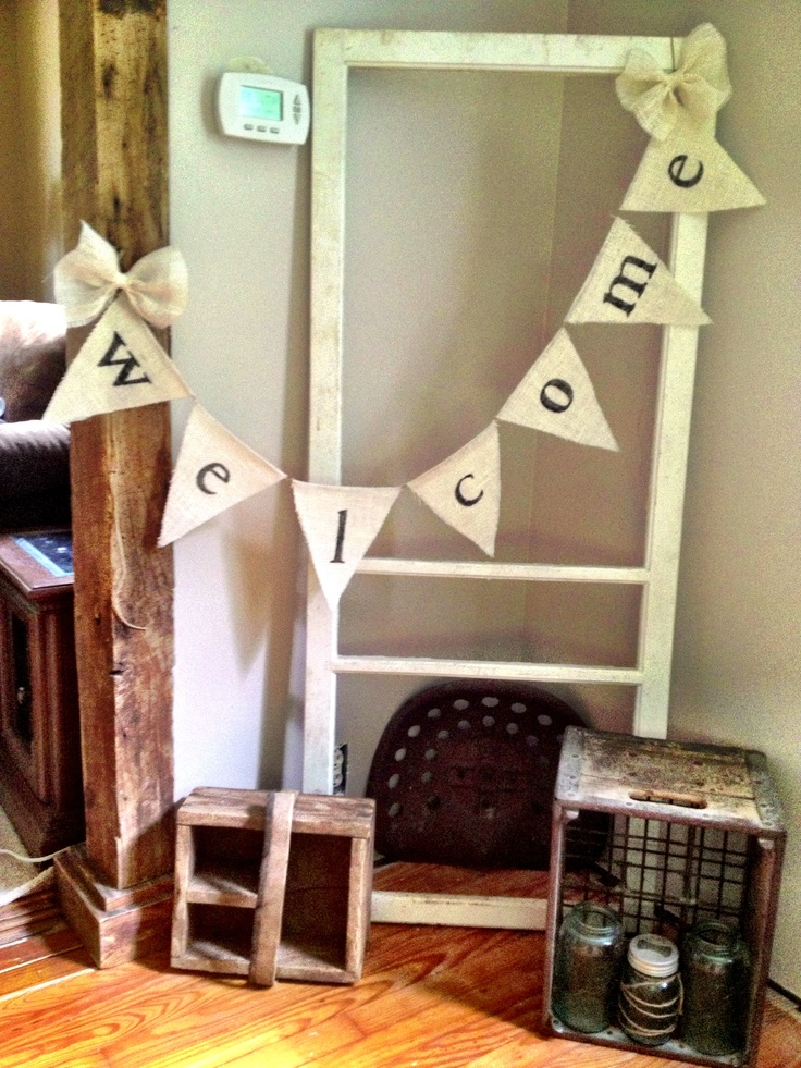 Cute DIY Burlap Banner.  Used a light burlap, cut out stencils with my circuit, glued the burlap triangles to twine.  Added burlap bows to ends of the banner!