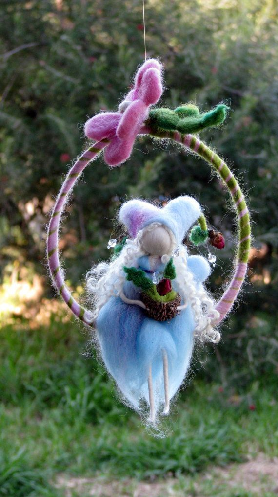 Waldorf inspired Needle felted fairy sitting on a twig holding roses Mobile #needlefelted #doll #nursery #mobile #home #room #home_decor #decor #fairy #fairytale