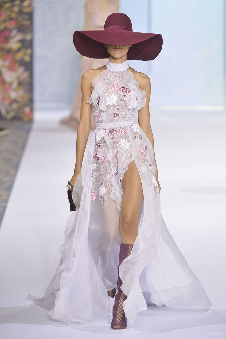 Sexy sheer maxi dress with front slit detail accented with a purple fedora and lace boots for Ralph & Russo Fall 2016