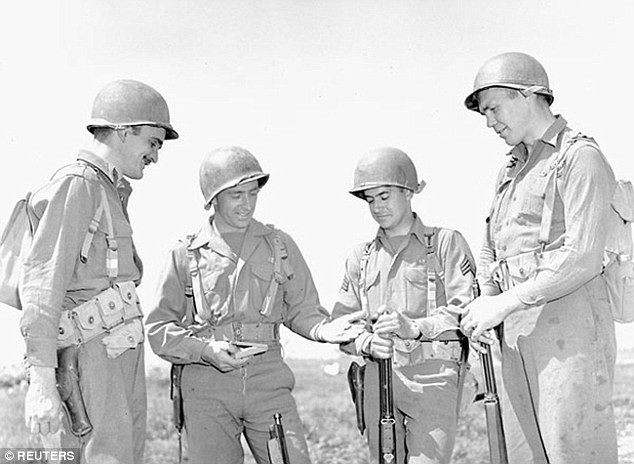The unit won five U.S. campaign stars and eight Canadian battle honors. Pictured: Private ...