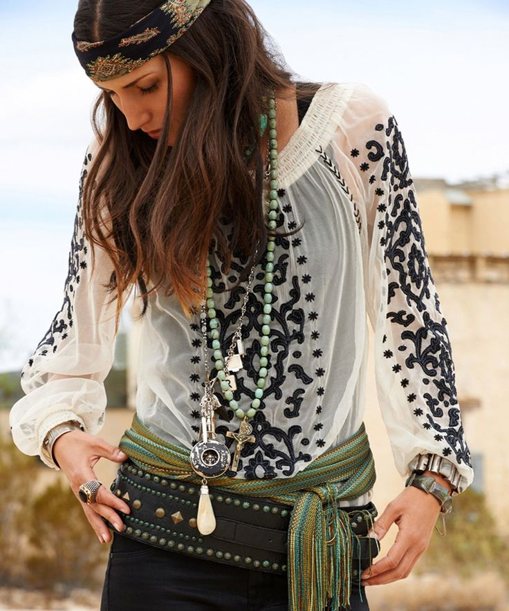 ~ Annette Peasant Blouse by Double D Ranchwear.  This blouse is a timeless piece.  Perfect over a black tank worn underneath.  Fluid, scoop neckline, raglan sleeves with black velvet detailing front & back.  I love how it's teamed with a wide leather belt [with studs & nail heads] at the hip, wrap belt above it, soft necklaces and scarf tied around the model's head.  When worn with boots, jeans or leather pants, this is my brand of [gypsy] Boho! ~