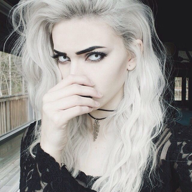 Intense contacts, pale makeup, bold eyebrows
