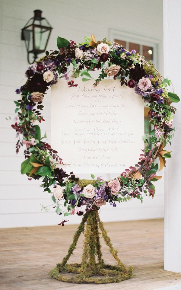 Purple floral wreath around reception menu - idea could be used for the table plan too
