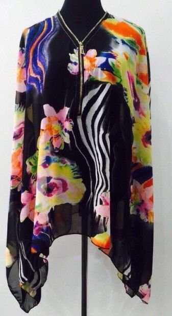 My Kaftan Top zip front BNWT  by ! Size 14 / L for £6.00. Check it out: http://www.vinted.co.uk/womens-clothing/other-tops/6510020-kaftan-top-zip-front-bnwt.