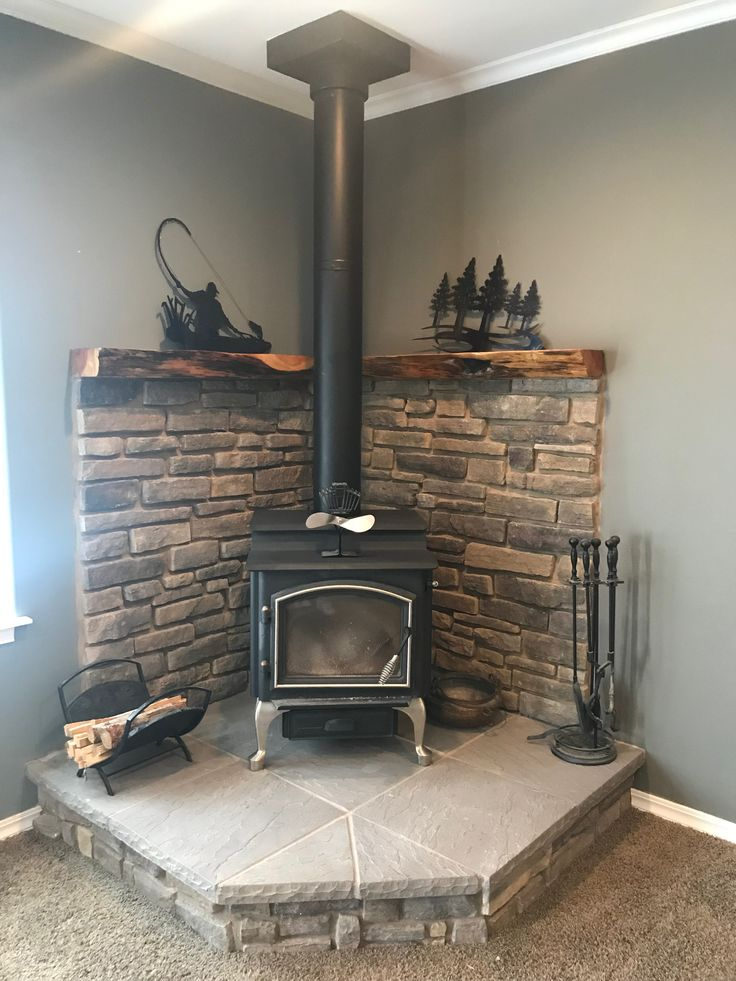 Corner wood stove fireplace with juniper mantel