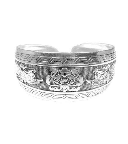 Miao Silver Cuff Bracelet Wide - Phoenix & Lotus Framed Penelope Jewelers. $13.99. This is a beautiful Miao Silver cuff bracelet featuring a pair of phoenix and a lotus flower.. Beauty and luck meets creativity and fortune.. These are symbols of beauty, luck, and virtue.. Dimension & Measurement: Cuff approx 7-inches end to end & approx 1-inch wide. The Miao Silver cuff has an antique-like finish. This piece has a sense of balance and peace!. Save 36% Off!