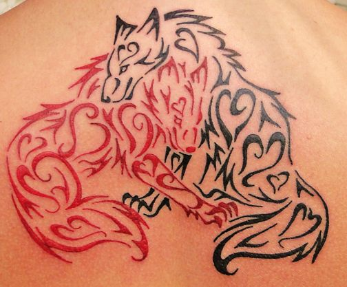 Black wold and red fox tattoos