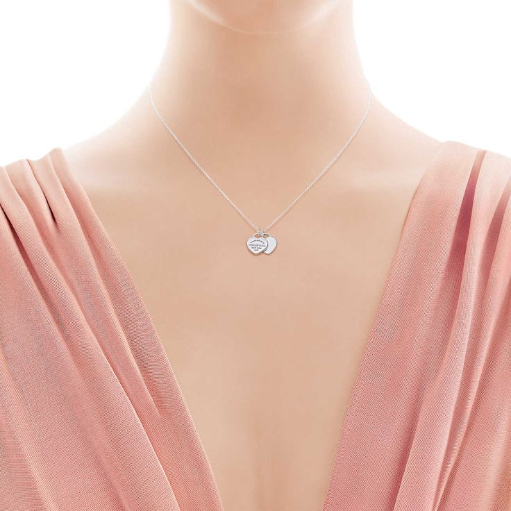 Return to Tiffany™ mini double heart tag pendant in sterling silver.