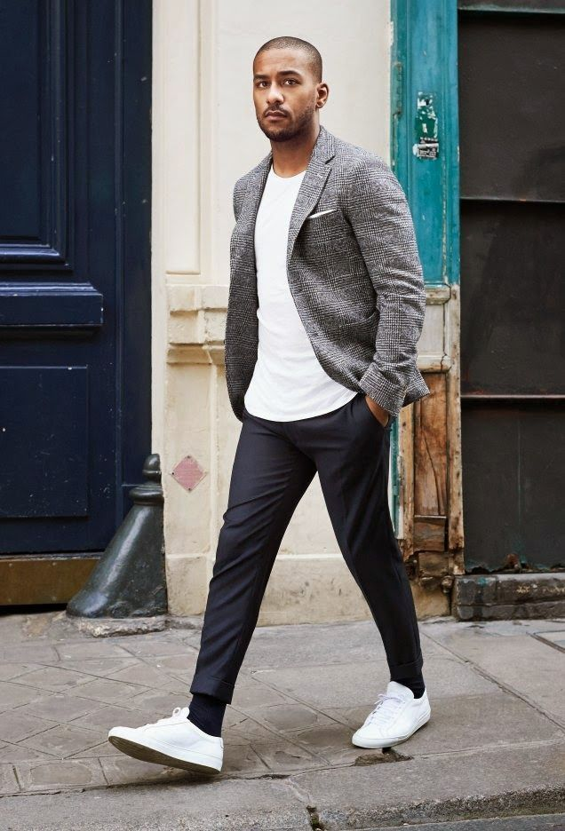 Make grey tartan blazer and dark grey suit pants your outfit choice for a sharp, fashionable look. White low top sneakers will contrast beautifully against the rest of the look.   Shop this look on Lookastic: https://lookastic.com/men/looks/blazer-crew-neck-t-shirt-dress-pants-low-top-sneakers-pocket-square-socks/12462   — White Pocket Square  — White Crew-neck T-shirt  — Grey Plaid Blazer  — Charcoal Dress Pants  — Black Socks  — White Low Top Sneakers