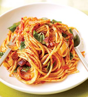 This 20-minute recipe features pasta in a bacon and basil tomato sauce. Use any strands of pasta you have on your shelf--spaghetti, angel hair, or linguine.  I grew up on a variant of this.. It is so yummy! We used tomato soup instead of tomato sauce :)