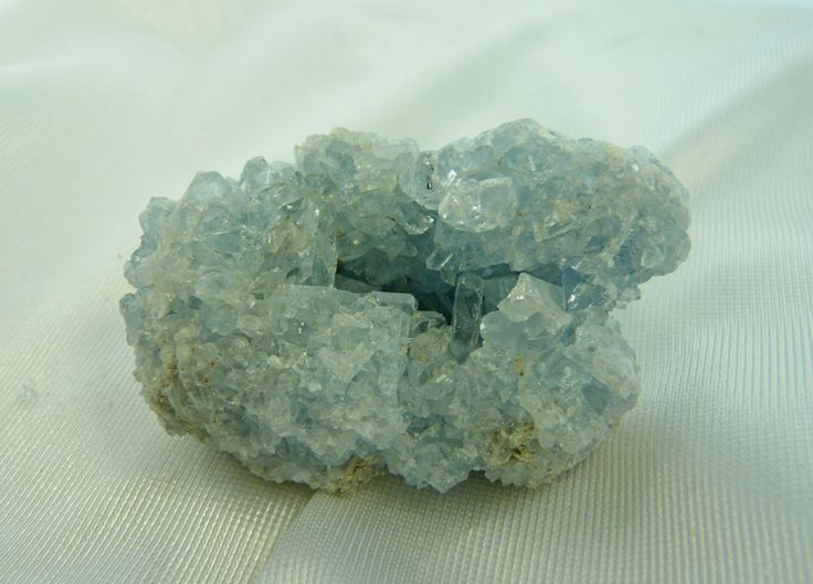 MADAGASCAR CELESTITE LOOSE STONE  Madagascar's Blue-gray Celestite comes primarily in clusters. Celestite offers a gentle, uplifting energy which can raise and expand one's awareness and is excellent for your emotional state as it is calming and aids mental clarity as it clears and sharpens mental faculties.  Weight: 210 grams Length: 3 in Height: 1 3/4 in Width: 1 3/4 in