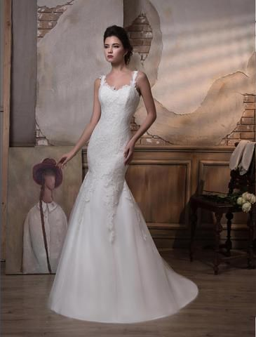 Molly - is a charming trumpet style wedding dress with lace bodice and slight sweetheart neckline, flowing into a satin skirt with soft tulle overlay and train.