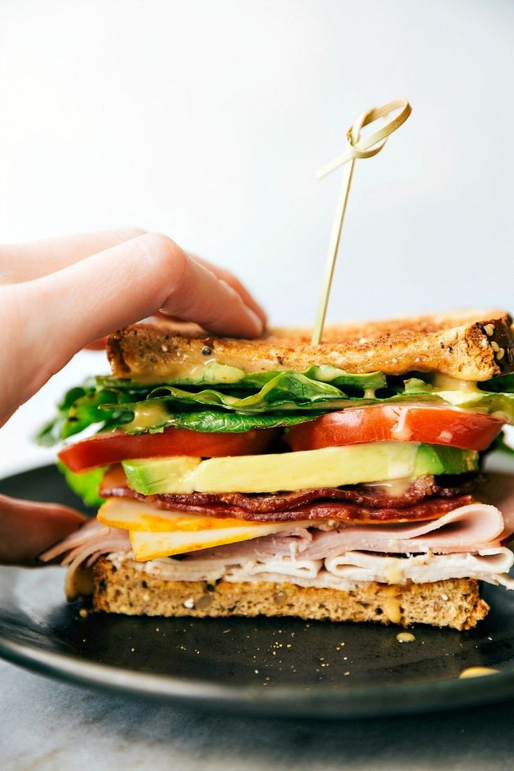 Honey Bacon Clubs -- toasted bread, crisp fresh veggies, smoked turkey, honey ham, center-cut bacon, muenster cheese, and the most incredible SECRET INGREDIENT honey mustard spread! via chelseasmessyapron.com