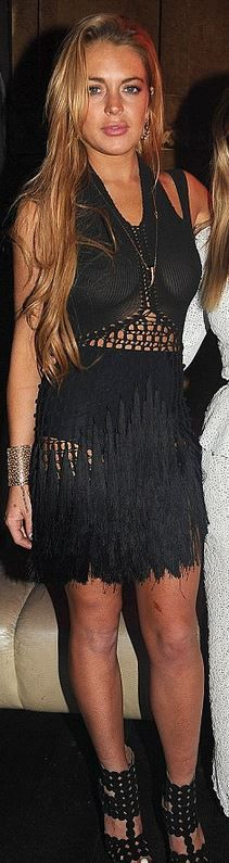 Who made  Lindsay Lohan's black fringe dress and black circle sandals that she wore in Miami?