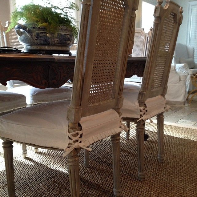 CasaGiardino Antique Caned Back Dining Chairs Wearing Their New White Denim Seat Slipcovers With Mini Running Pleats And Ties