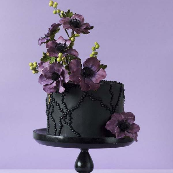 Dramatic Black Cake  Purple Flowers