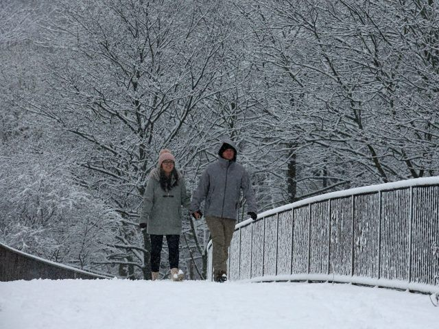 (Andrew Milligan/PA) Snowfall Hits UK As 'Severe Weather' Rolls Across Country: A couple walking through the snow in Glasgow