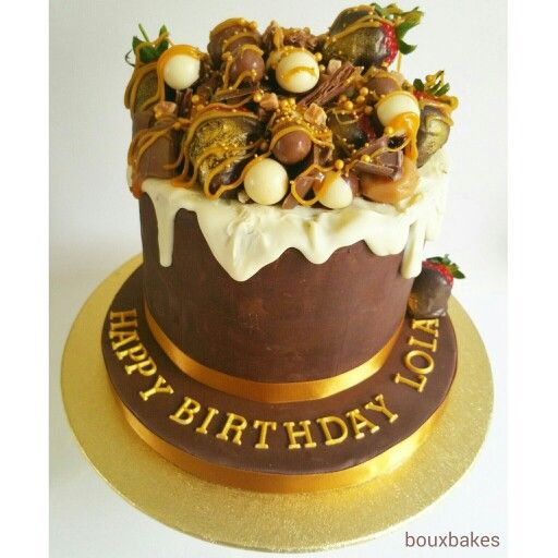 Chocoholic's Dream! Chocolate fudge salted caramel cake encased in dark chocolate ganache topped with caramels and chocolate Golden strawberries