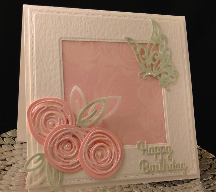 Shawn Bday 2017 Joy Craft butterfly cut in green pearl paper. Roses cut in two sizes in two shades of pink cards stock. Leaves cut in both vellum and green pearl paper. Happy Birthday cut in green pearl paper and pink paper and off set which you cannot see in the photo. The middle panel is a rose imprinted vellum with pink behind so you can see the roses. Hammered card stock used for base and frame. Created by Peggy Dollar