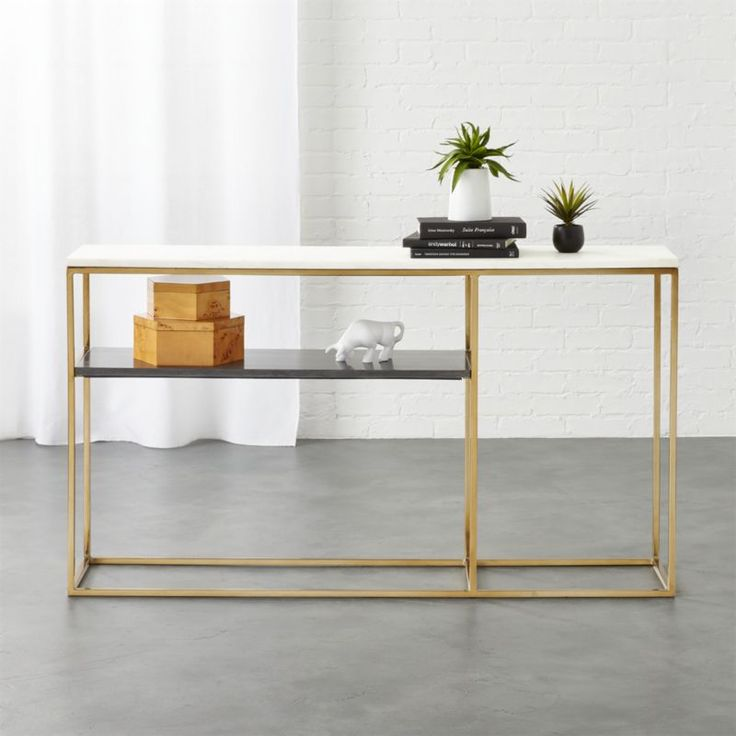 Shop 2 tone marble console.   Clean lines and sleek metal meet the natural warmth of real marble for an eclectic modern mix.  Linear open frame in warm brass supports two marble shelves––one white, one grey.