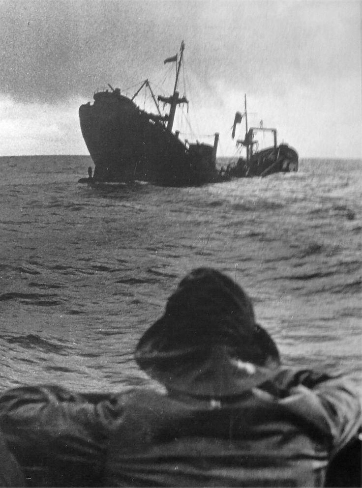 The general cargo ship Beacon Grange sinks after being torpedoed amidships by U-552 on April 24, 1941. Photo taken from the submarin'es coning tower. German submariners routinely machine gunned seamen who survived the initial blast and found themselves in the water.