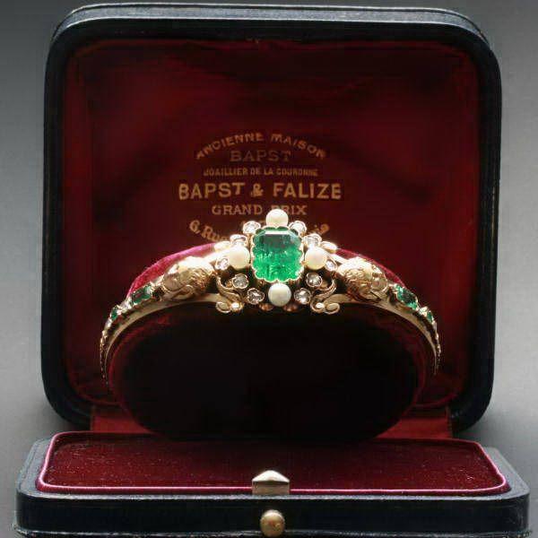 Victorian emerald and pearl bangle bracelet. Includes 14 rose cut diamonds. c.1870
