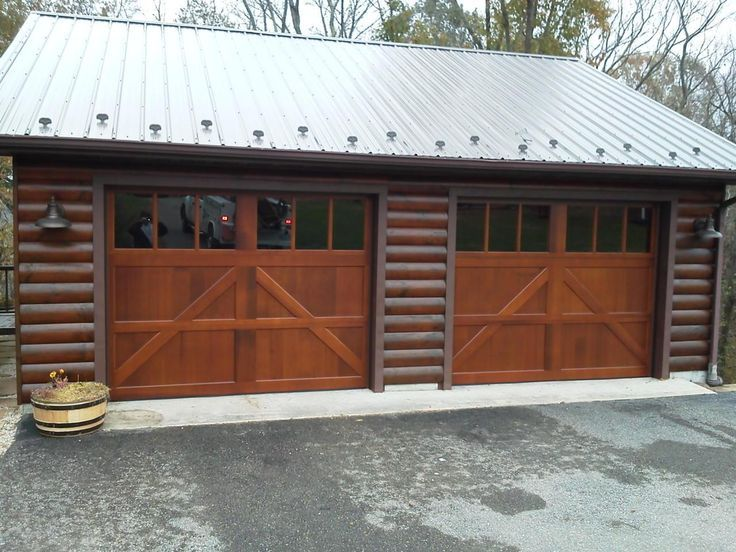 41 best wood carriage house garage doors images on for Log cabin style garages