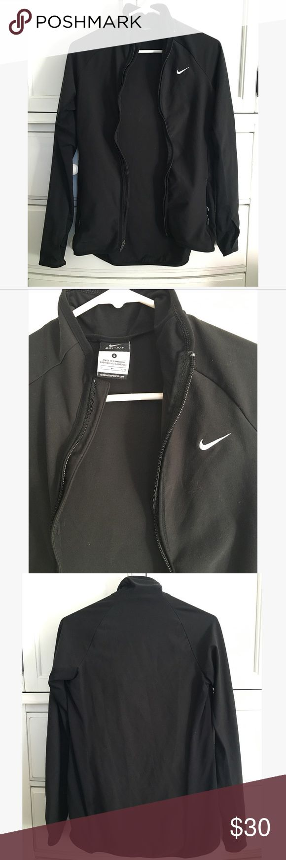 EUC Nike Black Zip Up Sz S EUC Nike Black Zip Up size small. Lighter shade of black on front and back with a dark shade of black down the sides. Two zip pockets and thumbholes. Great light jacket! Nike Tops Sweatshirts & Hoodies