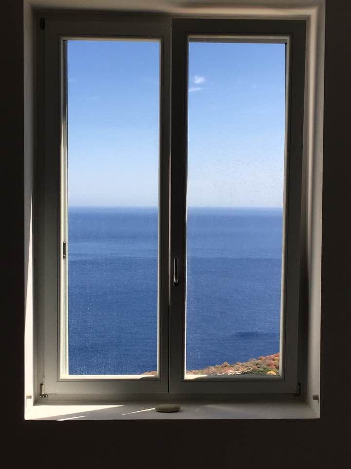 Accoya wood window frames and spectacular view in Sifnos island, Cyclades, Greece