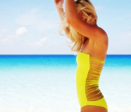 Suit up in this trendy yellow one-piece
