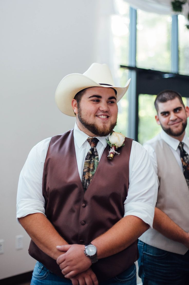 Grooms first reaction to bride - Brown vest with camo tie, shotgun shell boutonniere & cowboy hat