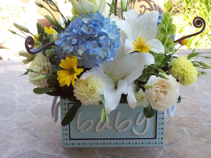 baby shower flowers arrangements | THE FLOWERS: I picked up these cute brown and blue boxes at Michael's ...