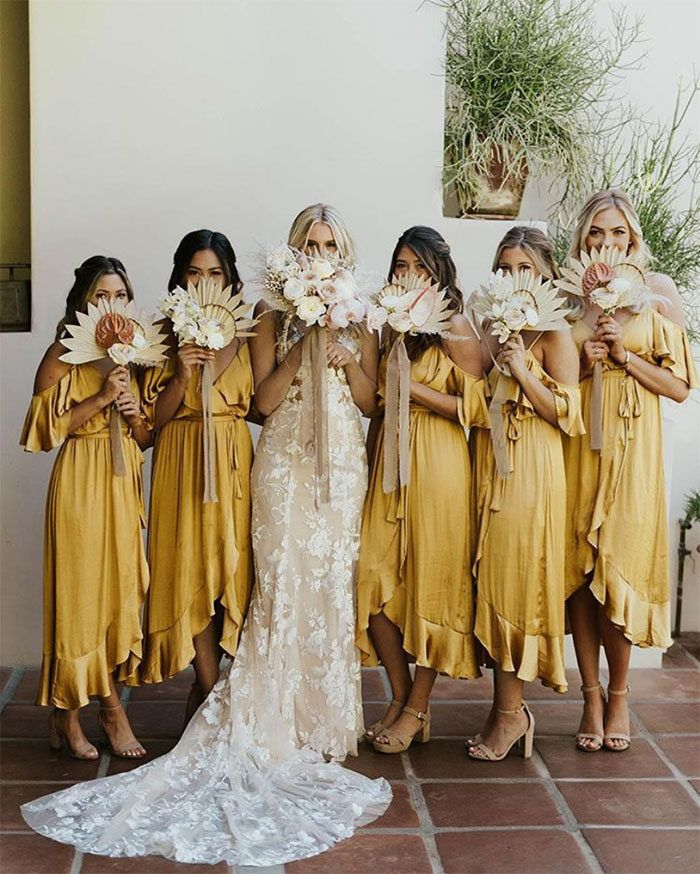 Off the Shoulder Boho Bridesmaid Dresses in Mustard Yellow with Neutral Protea Bouquets