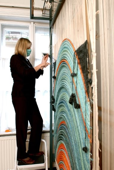 Anna Kubinyi uses a hanging loom to make amazing 3-dimensional woven art.