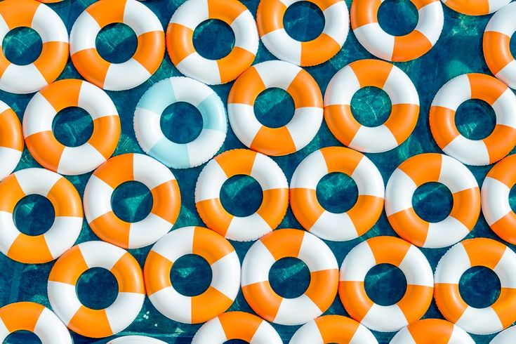 """""""Poolside, Mediterranean"""" is a series of colorful aerial captures by photographer Gray Malin.   The series was inspired by the glamour of the 1960s and shot in Europe along the coast of Spain.  """"The inner tubes were designed specifically for this shoot to embody the chic nostalgia of life savers.""""  — Gray Malin  More photography inspiration via Ufunk"""