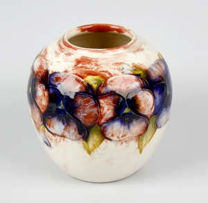 LOT:57   An unusual Walter Moorcroft 'Pansy' pattern vase