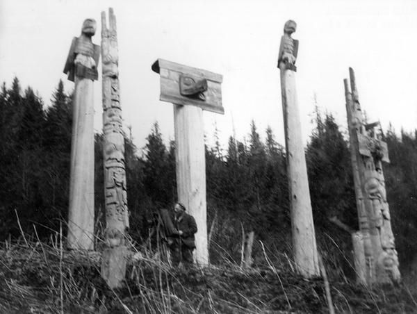 Memorial poles, a mortuary pole and the frontal pole associated with the Sky House.